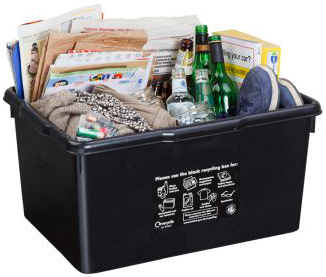 Photo of a black recycling box filled with items.